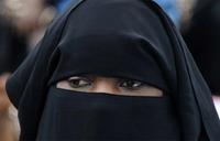 Dutch ban on burqas in public places takes effect
