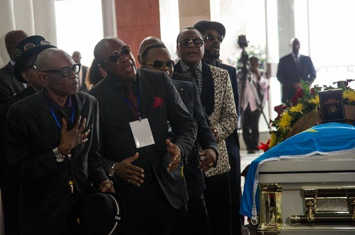 rtists sing over the coffin of rumba musician apa emba during his funeral in inshasa on ay 2 2016 emocratic epublic of ongos rumba king apa emba was posthumously awarded one of his countrys highest honours a week after he collapsed on stage and died aged 66