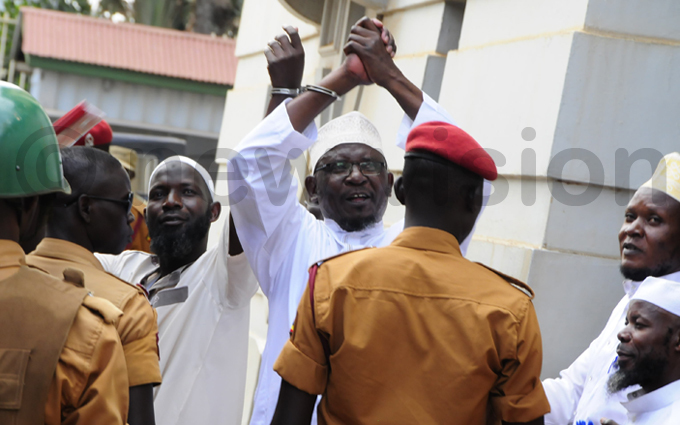 heikh unus amoga gestures while leaving court following the sentencing hoto by ddie sejjoba