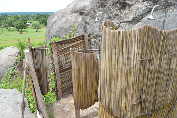 athrooms made out of papyrus reeds mounted with washing showers at agulu hill agulu ub ounty uyende district