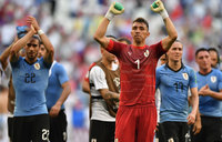 Uruguay beat hosts Russia to win Group A