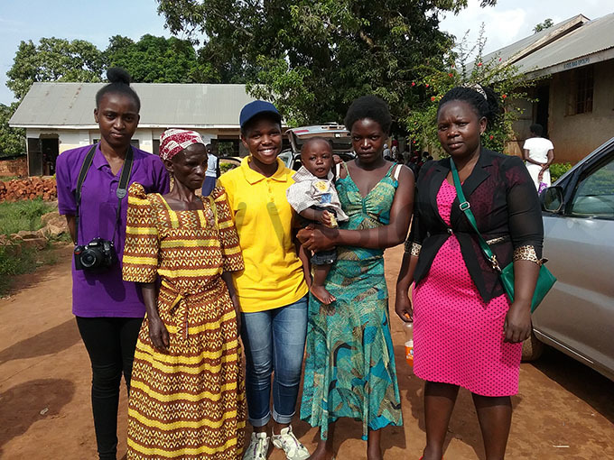ansubuga on the right with some of her ayaza igh school learners and a young teenage mother and  her mother