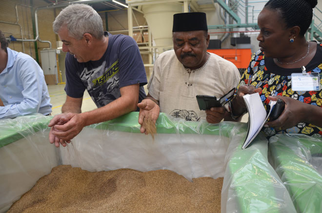 armers visiting ejo a seeds processing plant