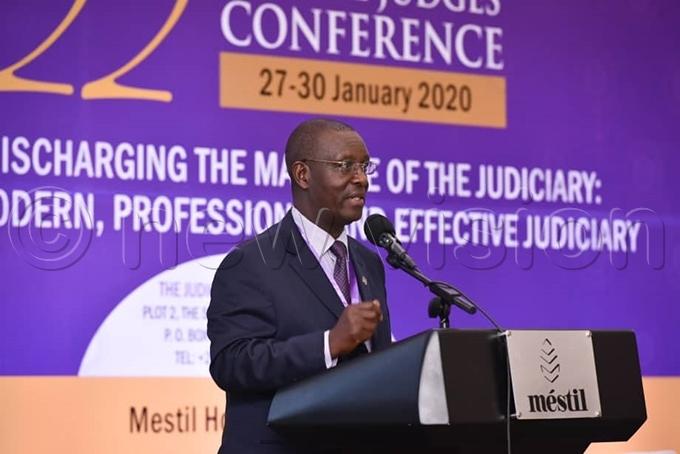 udiciary permanent secretary ius igirimana addresses the conference hoto by iriam amutebi