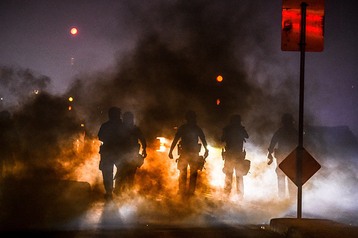 olice use tear gas to disperse protesters during a demonstration in inneapolis innesota on ay 29 2020 over the death of eorge loyd a black man who died after a white policeman kneeled on his neck for several minutes  hoto by handan