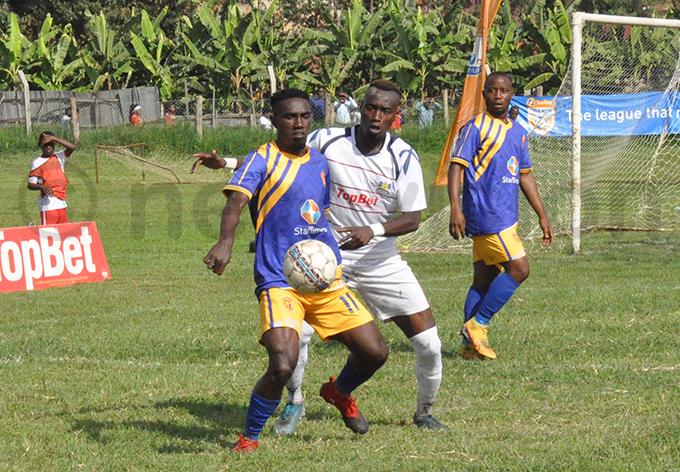 s risa sekisambu keeps a barara ity defender at bay during the game hoto by loysius yamukama