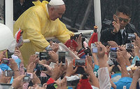 Millions gather for pope in stormy Philippines
