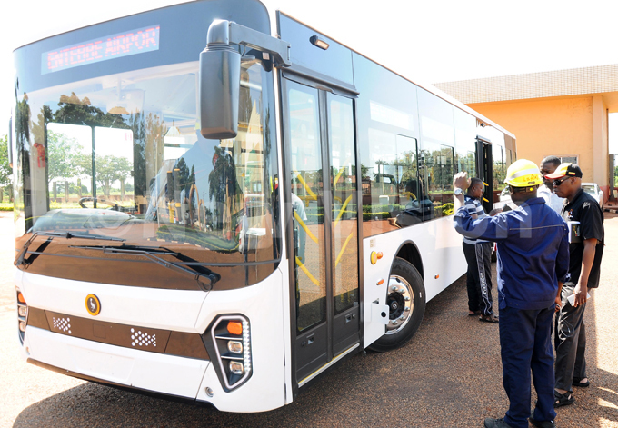 ichard adanda with a helment director of product development in uwero explaing how the new ayoola bus operates on ovember 16 2019