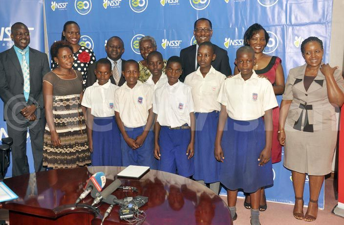 xecutive irector ennifer usisi 2nd right   anaging irector ichard yarugaba 5th right and arsh aster iria ugomwa center back pose with  officials and children of yamula rimary chool during the launch of the  ampala ash 7 ills un an initiative aimed at raising sh240m to be channelled to ampala chools at  offices arch 22 2016 hoto by ichael subuga