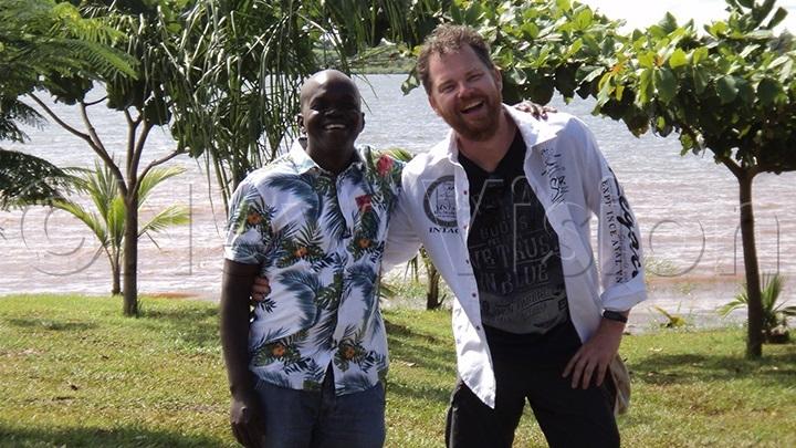 Ojambo with Van Espelo at the beach