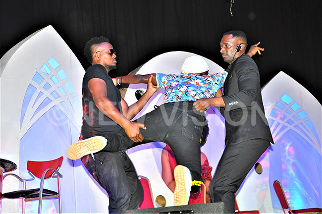 abwiso right doing his bodyguard job on stage