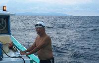 Japanese man, 73, completes record swim across strait