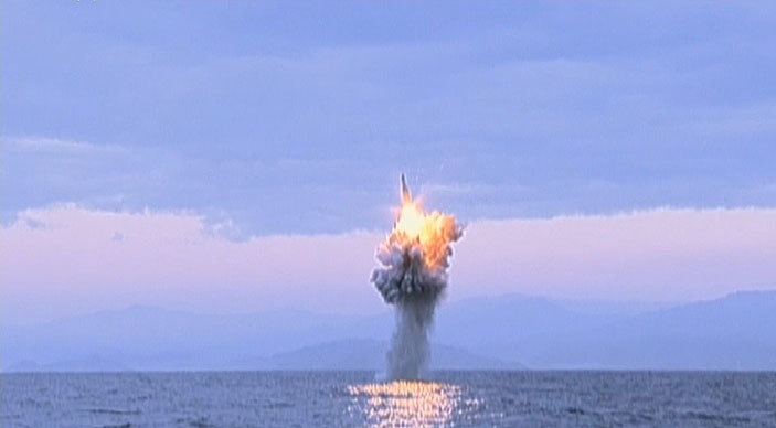 missile being launched vertically from underwater and igniting in mid air from off the coast of orth orea purportedly on ecember 21 2015