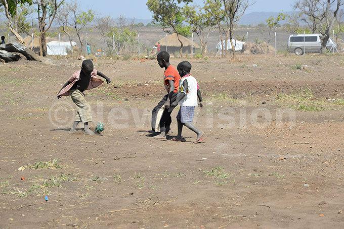 hildren enjoy a game of football  hoto by ndrew asinde