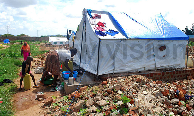 n arch this year this resident of usanja whose home was demolished did laundry in front of a makeshift tent her family shared with another family redit awrence ulondo