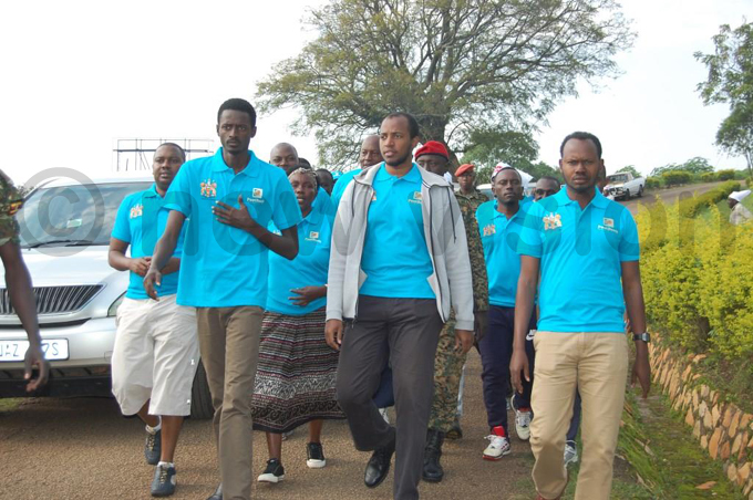 ingo yo flanked by kingdom officials arrives for the start of the marathon hoto by ilson siimwe