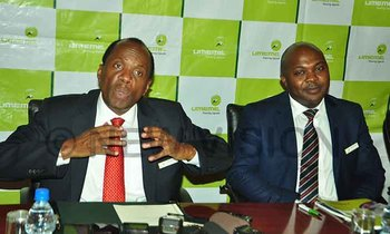 Bitature left addresses journalists after umeme s annual general meeting at kampala serena hotel as selestino babungi the company s managing director looks on recently photo by benon ojiambo 350x210