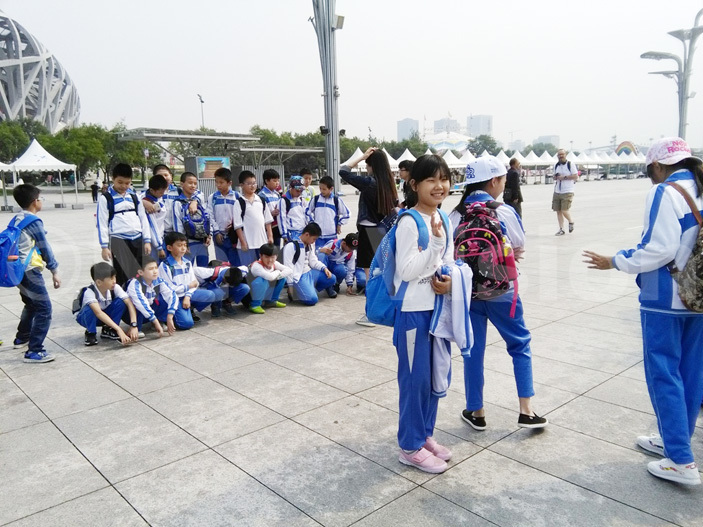 hinese students on a tour of the stadium