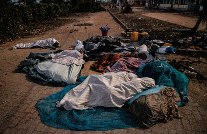 eople who lost their home by the cyclone dai sleep on a street as they stay in shelter in uzi ozambique  hoto