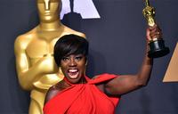 Black actors triumph at very political Oscars