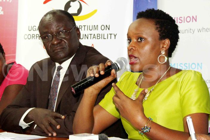 he executive director lobal rights alert infred gabiirwe addressing the press