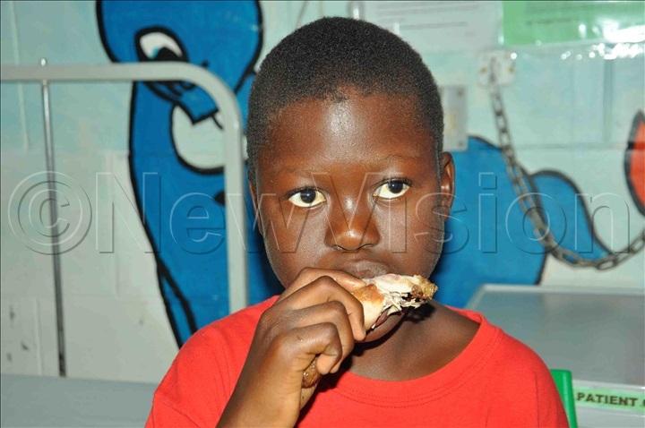 Kiryowa enjoying a piece of chicken at IHK. Photo by Abou Kisige