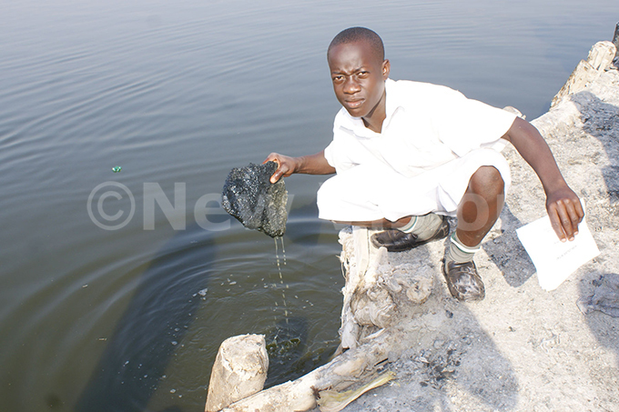 visitor lifts a rock salt piece mined from ake atwe
