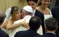 Remarried divorcees 'not excommunicated', pope tells Church