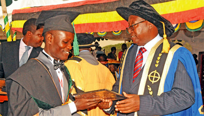 graduate receiving a convocation prize for academic excellence from rof ugyenyi on aturday