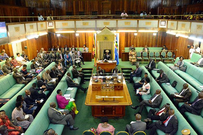 Members of Parliament debate during plenary on Wednesday. (Photo by Eddie Ssejjoba)