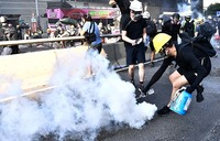 Clashes, travel chaos in Hong Kong as leader warns city on brink