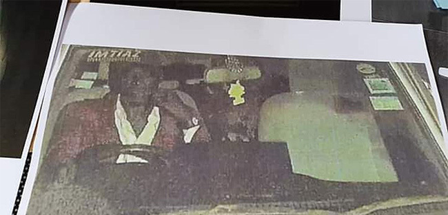 printed copy of the grainy images of the suspected assailant redit ganda olice orce
