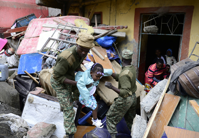 enyan security forces carry a girl as people are evacuated from the vicinity of a collapsed building  hoto