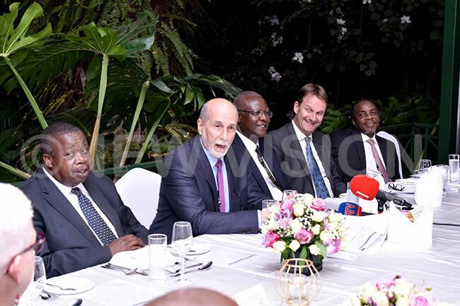 eft to right  tafire acifici atureebe enk akker the utch mbassador to ganda and yaruhanga during the  meeting