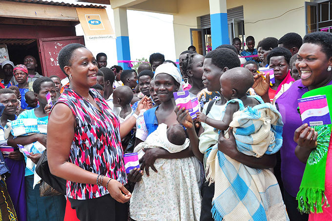 ganda oucher lus ctivity hief of arty hristine amayanja interacts with some of the mothers after the community health insurance meeting at lleluyah oint maternity linic in lebtong district hoto by uliet asirye