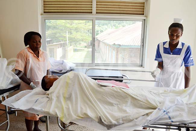 urses move a fistula victim from theatre