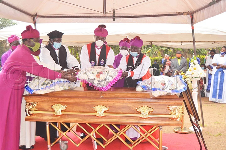 Anglican Prelates laying a wreath on the casket of Ruth Ddungu during the funeral service