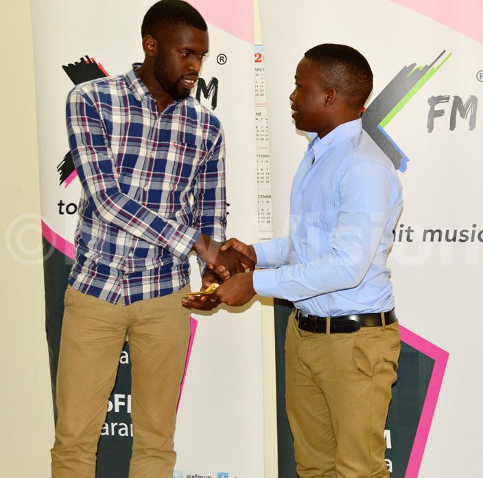 he rap artiste enezeri hibita left hands over sh300000 to avid amanga  e scored 3 s in hysics hemistry and athematics in last years   exams