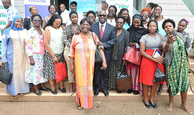 he ision roup hief xecutive fficer obert abushenga on red tie takes photograph with group of floweriest during arvest oney expo exhibitors meeting on 4 ebruary at amboole tadium hoto by lfred chwo