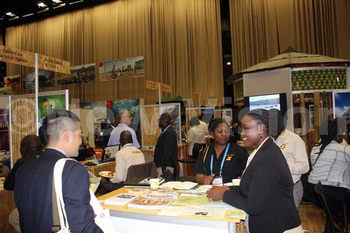 gandan exhibitors enlighten a visitor on some of the experiences ganda offers