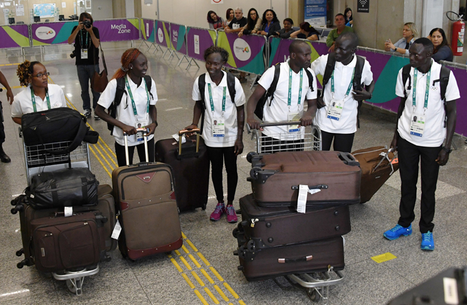 he outh udanese refugees arrive at the nternational irport ntonio arlos obim airport in io de aneiro razil on riday  hoto