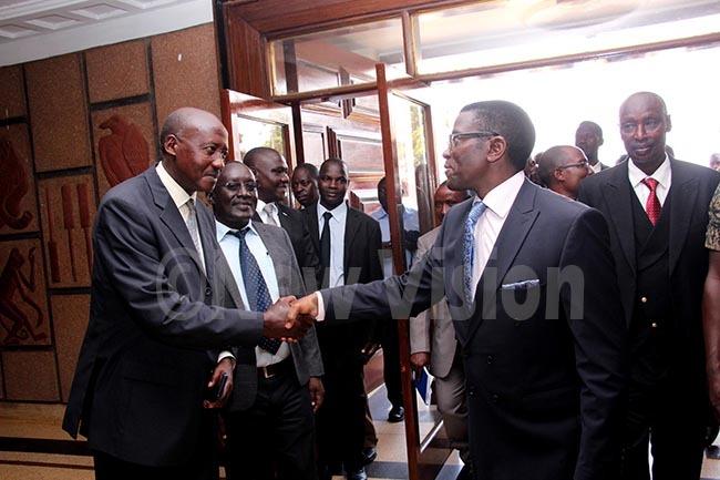 he atikiro of uganda harles eter ayiga right shaking hands with utambala eputy aza chief usa ubega at ulange engo on hursday 7th ovember 2019photo by van abuye