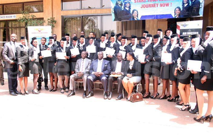 tudents of ganda viation chool pose for photos with invited guests at rotea otel during the 3rd graduation ceremony hoto by yet kwera