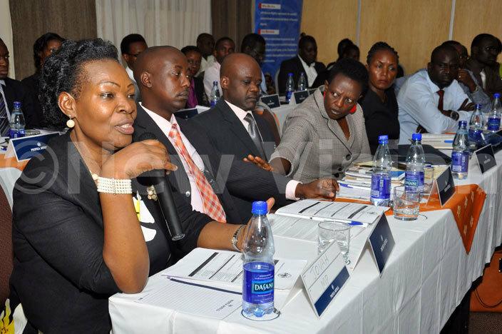 ovia amateka addressing participants during the launching of the ganda uman ights ommission database and search engine