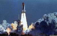 US remembers astronauts killed, pledges to reach Mars