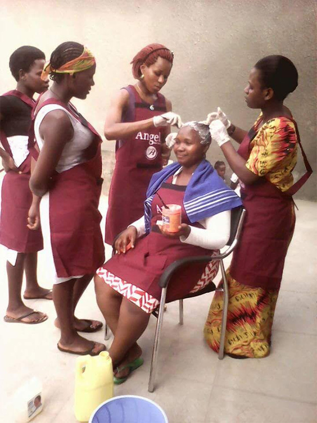 ouths doing hair dressing at  offices in ansana akiso district