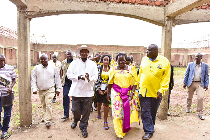 atherine amwaka centre takes resident useveni on a guided tour of construction works at moro district headquarters  hoto