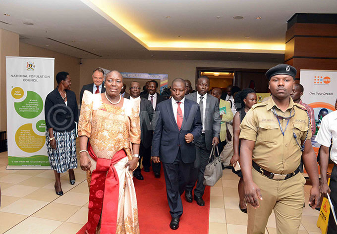 peaker of arliament ebeca adaga leaving after addressing the audience at the launch of the tate of opulation eport 2018 n the center is state minister for finance avid ahati hoto by ddie sejjoba