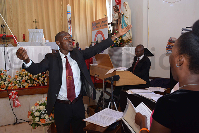 hoir conductor immy vini during the service hoto by imothy urungi