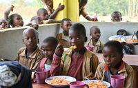 Women's bank helps Ivorian children to swap labour for class
